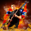 Rock guitarist play on the electric guitar around fire flames — Stock Photo #6371819