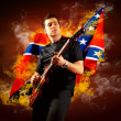 Rock guitarist play on the electric guitar around fire flames — Stock Photo #6371823