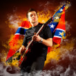 Rock guitarist play on the electric guitar around fire flames — Stock Photo #6371831