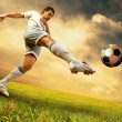 Happiness football player on field of olimpic stadium on sunrise - Stockfoto