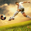 Happiness football player on field of olimpic stadium on sunrise — Stock Photo #6371855
