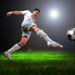 Happiness football player after goal on the field of stadium wit — Stock Photo #6371862