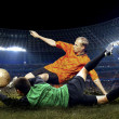 Football player and jump of goalkeeper on the field of stadium a — Stock Photo #6371868