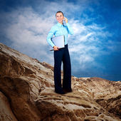Happy Businesswoman standing with laptop on the mountain under b — Stock Photo
