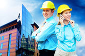 Young architects wearing a protective helmet standing on the bui — Stock Photo