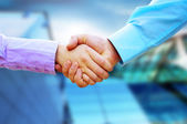Shaking hands of two business — Photo