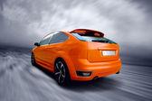Beautiful orange sport car on road — 图库照片