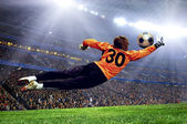 Football goalman on the stadium field — Stok fotoğraf