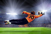 Football goalman on the stadium field — 图库照片