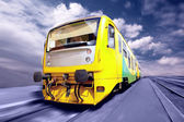 Yellow train on speed outdoor — Stock Photo