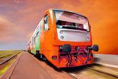 Orange train on speed outdoor — Stock Photo