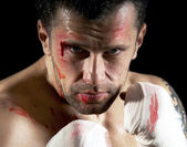 Aggressive boxer with blood on the face — Stock Photo