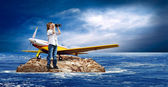 Child with airplane on the island in sea. — Stock Photo