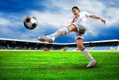 Happiness football player after goal on the field of stadium wit — Stok fotoğraf