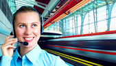 Businesswomen and train on speed in railway station — Stock Photo