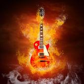 Rock guita v plameny ohně — Stock fotografie