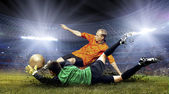 Football player and jump of goalkeeper on the field of stadium a — Stockfoto