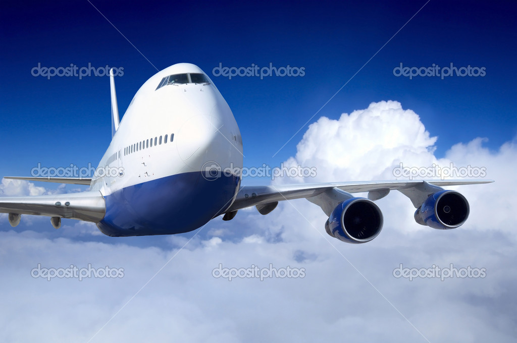 Airplane at fly on the sky with clouds — Stock Photo #6370447