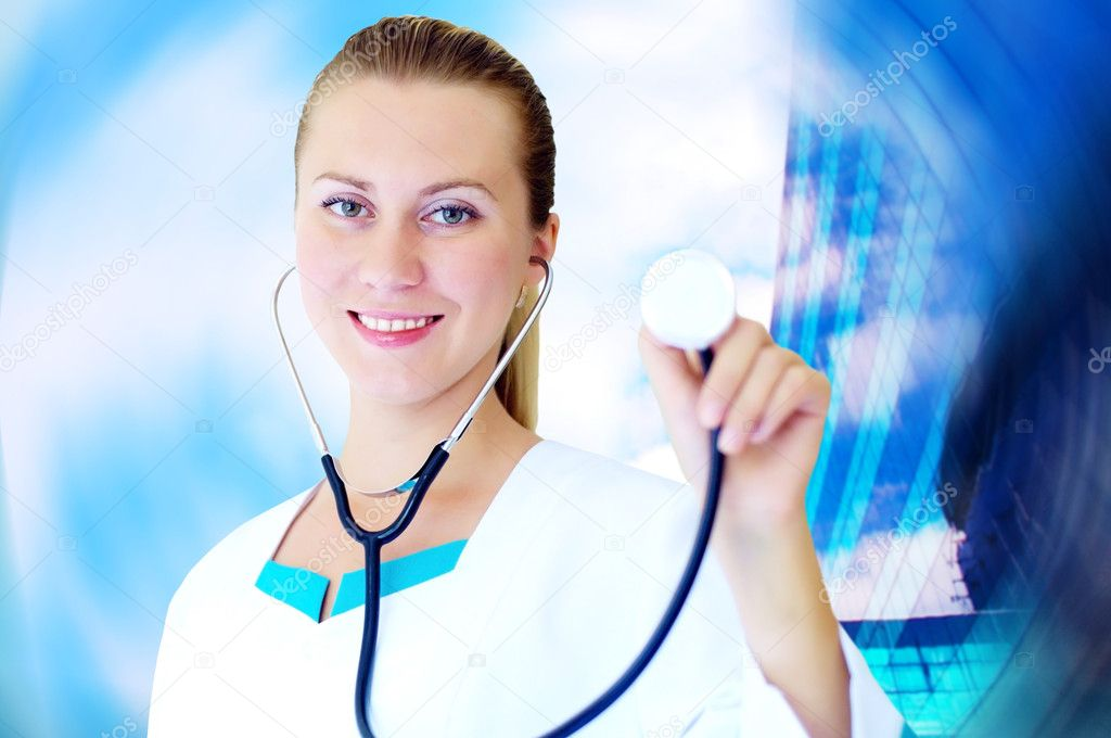 Smiling medical doctor with stethoscope on the hospitals background — Stock Photo #6370972