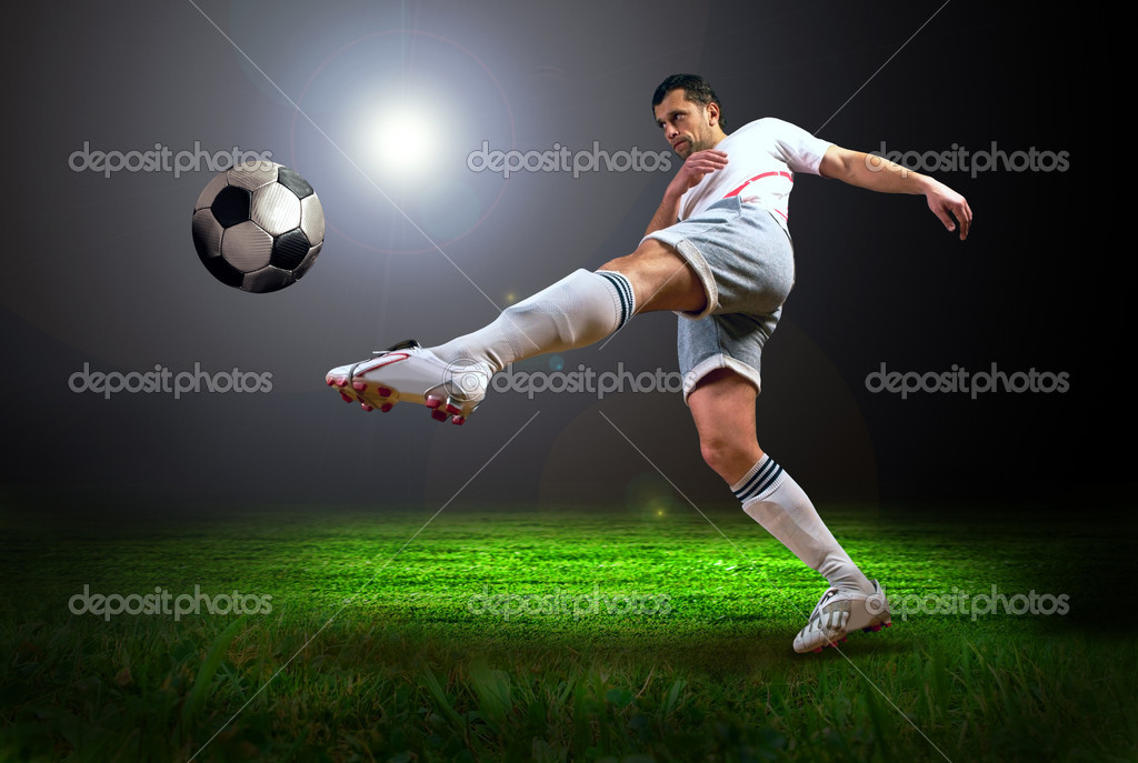Happiness football player after goal on the field of stadium with light — Stock Photo #6371860