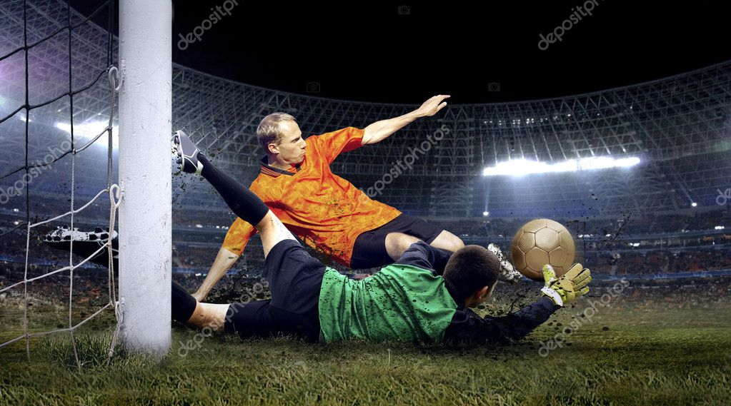 Football player and jump of goalkeeper on the field of stadium at night — Stock Photo #6371865