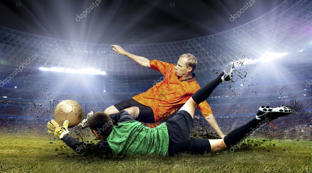 Football player and jump of goalkeeper on the field of stadium at night  Stock Photo #6371873
