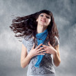 Stock Photo: Young beatiful caucasiwomen with hair on wind