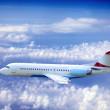 Airplane at fly on the sky with clouds — Stock Photo #6429921