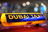 Dubai Taxi sign at night — Stock Photo