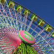 Stock Photo: Colorful ferris wheel against blue sky