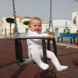 Happy baby girl in swing — Stock Photo #6376526