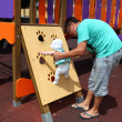 Father with little daughter on the playground — Stock Photo