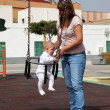 Mother with her daughter on the playground — Stock Photo #6376792
