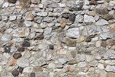 Old stone wall made of randomly stacked blocks — Stock Photo
