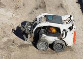 Mini excavator at construction site — Stock Photo
