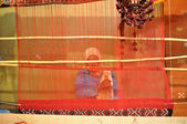 Berber woman weaving a carpet — Stock Photo