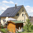 House with photovoltaic panels on the roof - Stock Photo
