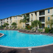 Stock Photo: Swimimng pool and Apartment houses