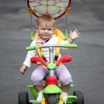 Little baby girl on bike — Stock Photo #6395200
