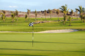 Golf course in tropical resort — Stock Photo
