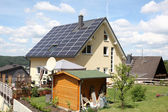 House with photovoltaic panels on the roof — Stock Photo
