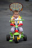 Little baby girl on bike — Stock Photo