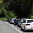 Cars in a traffic jam on a country road — Stock Photo