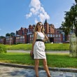 Young businesswomin white dress in city — Stock Photo #6211186