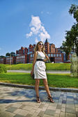 Young businesswoman in white dress in city — Stock Photo