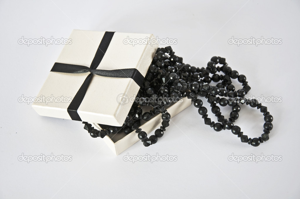 Casket with  beads on a white background  Stock Photo #6318732