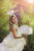 Beautiful angel girl in forest — Stock Photo