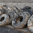 Stock fotografie: Wasted old tyres in harbour