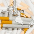 Map of Canada with cigarettes in background — Stock Photo