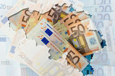 Outline map of Belgium with transparent euro banknotes in backgr — Stock Photo
